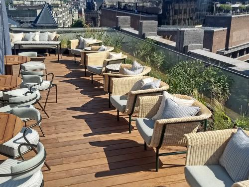 Roof terrace with wooden decking and chairs